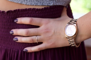 Deep plum nails are a fabulous addition shading nicely with her wine-colored skirt.